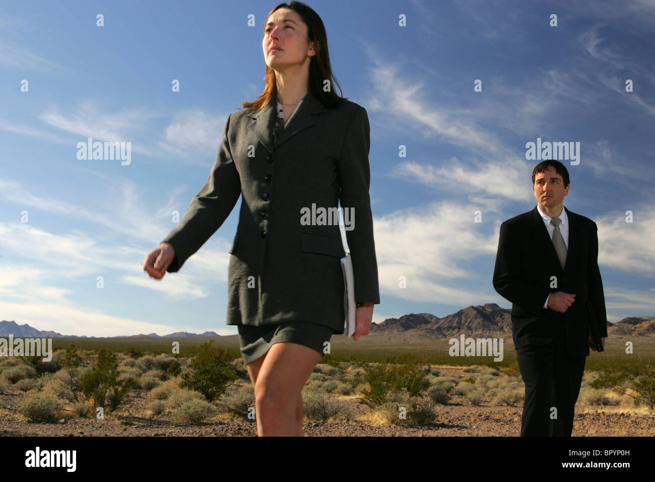Two business coworkers in the desert, Death Valley, California. - Stock Image