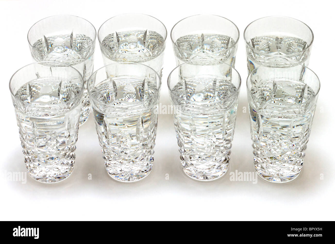 Eight glasses of water - Stock Image