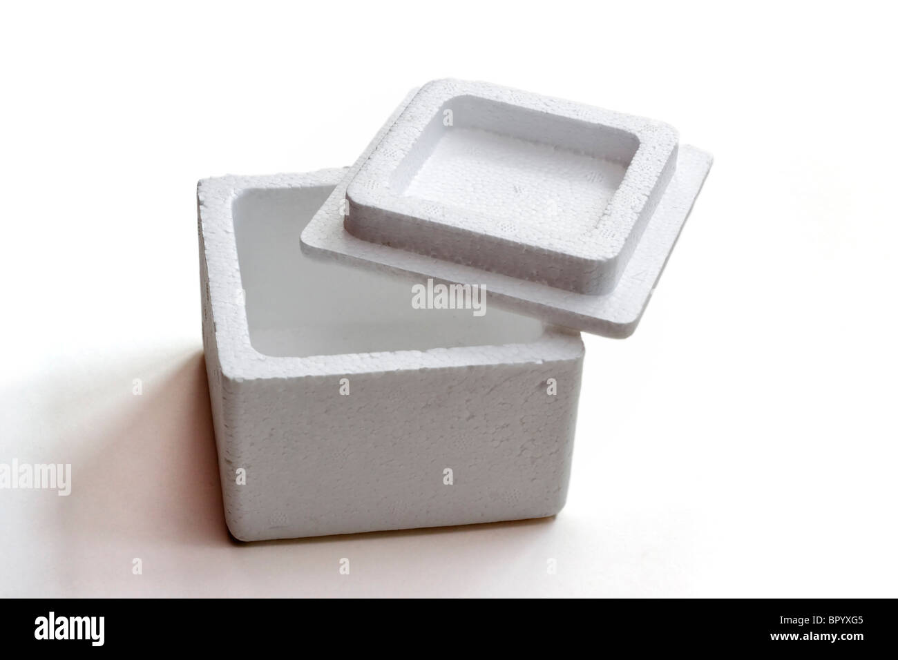 Empty styrofoam box with lid - Stock Image