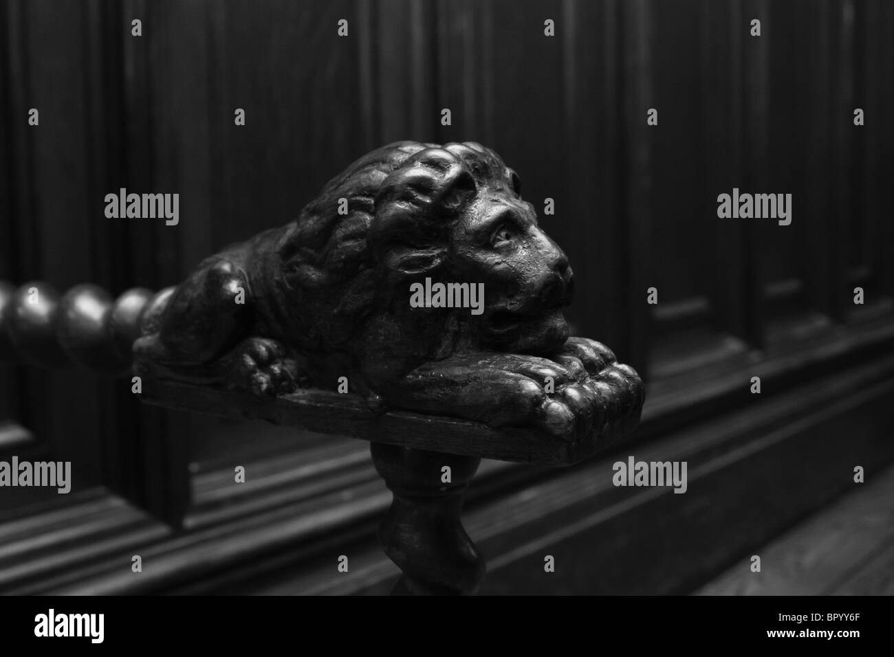 wooden lion armchair detail closeup - Stock Image