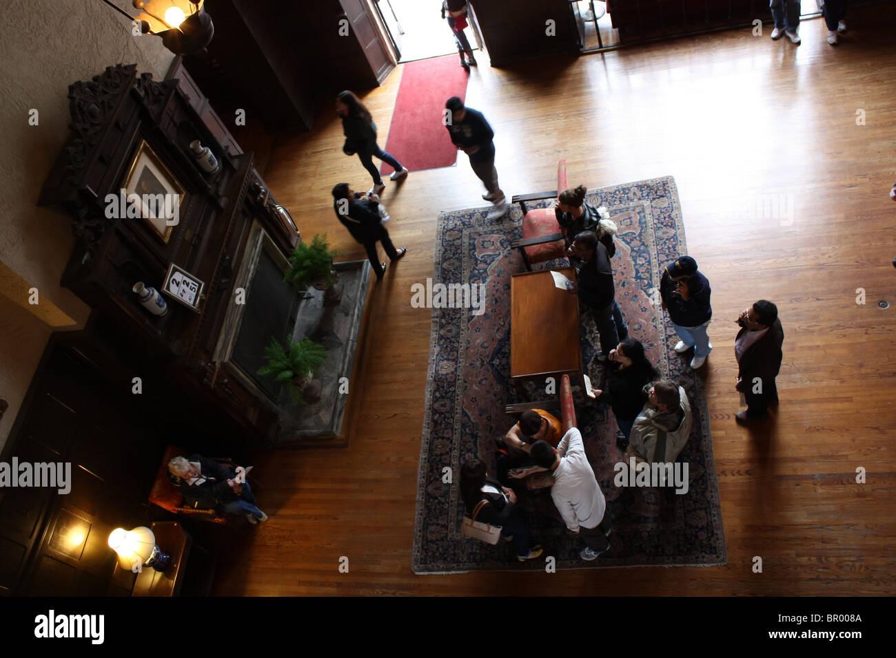 tourist gather inside casa loma overhead - Stock Image