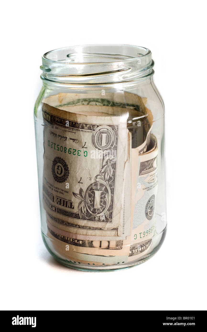 Money jar with US dollars - Stock Image
