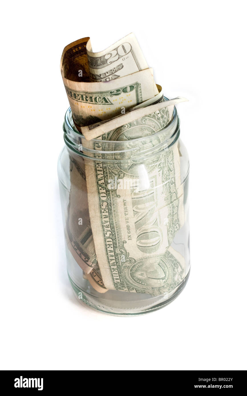 US dollars money in a glass jar - Stock Image