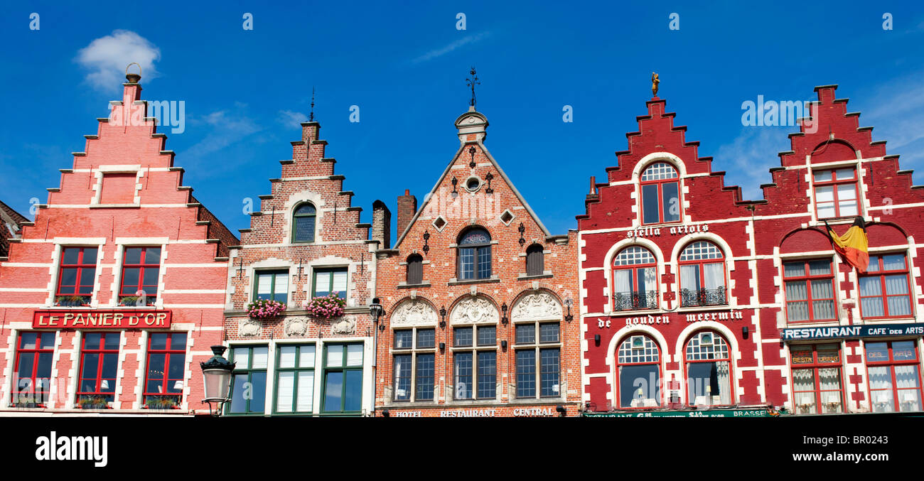 Row of ornate historic buildings in Market Square in Bruges in Belgium - Stock Image