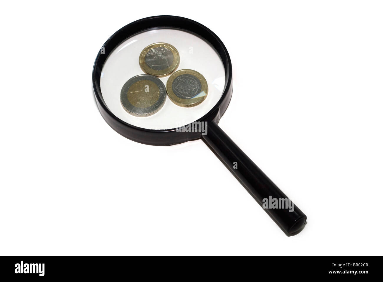 Euros under a magnifying glass Stock Photo