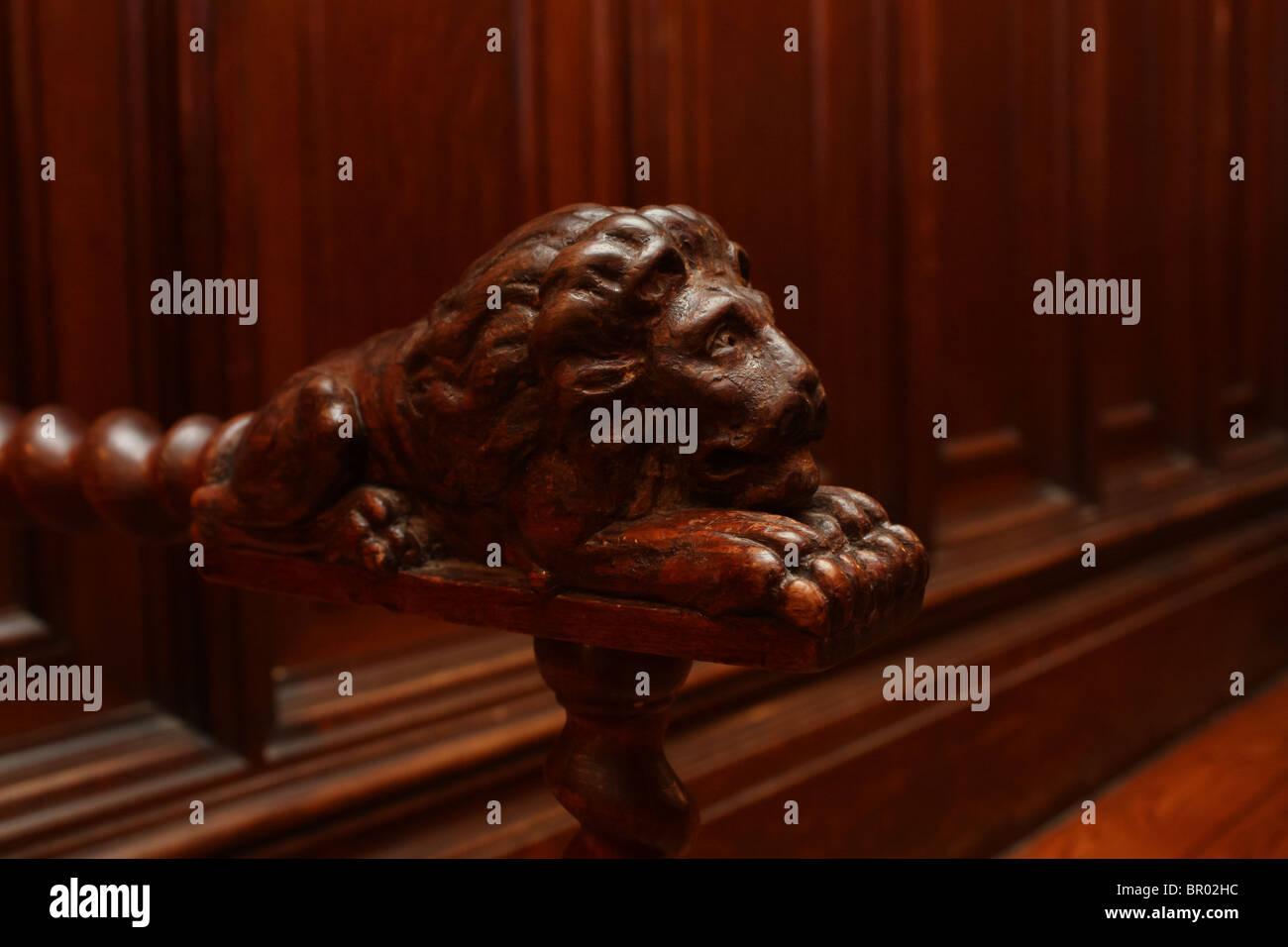 wooden lion armchair detail closeup - Stock Image