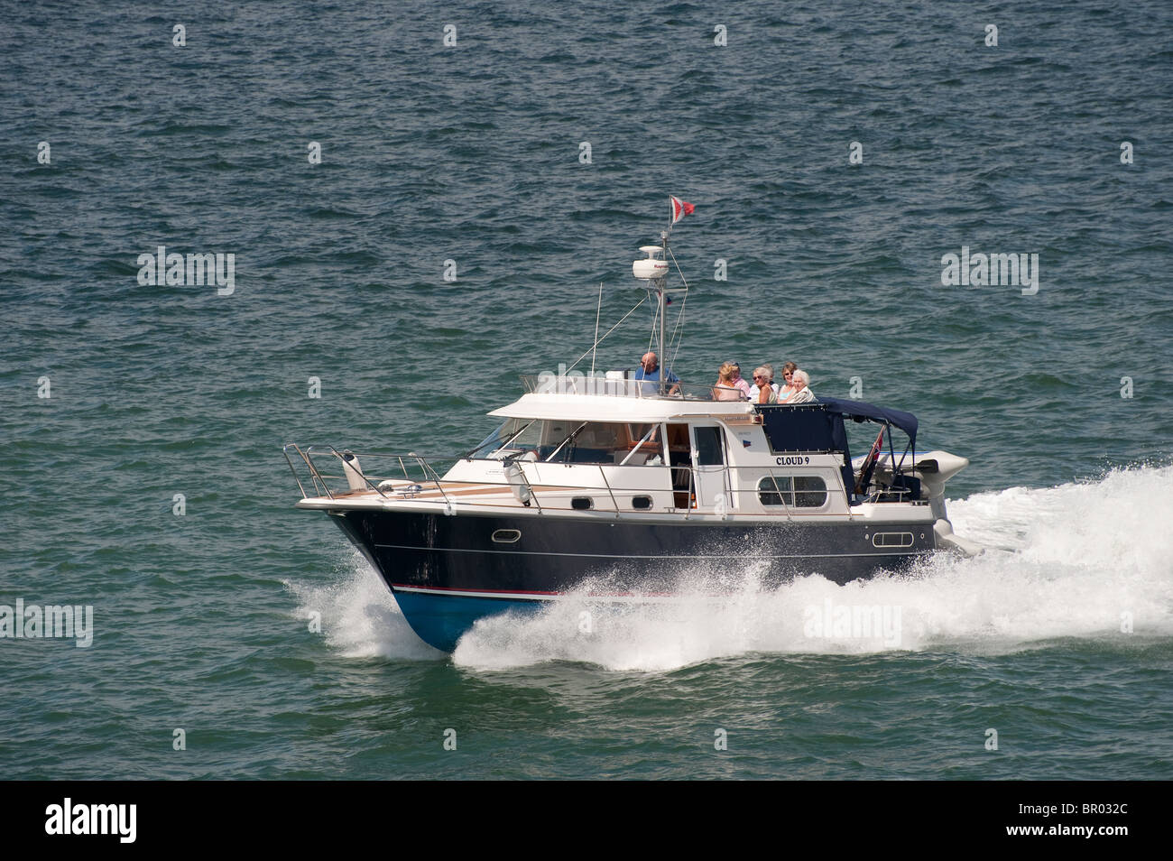Nimbus Commander offshore powerboat speeding through the water. - Stock Image