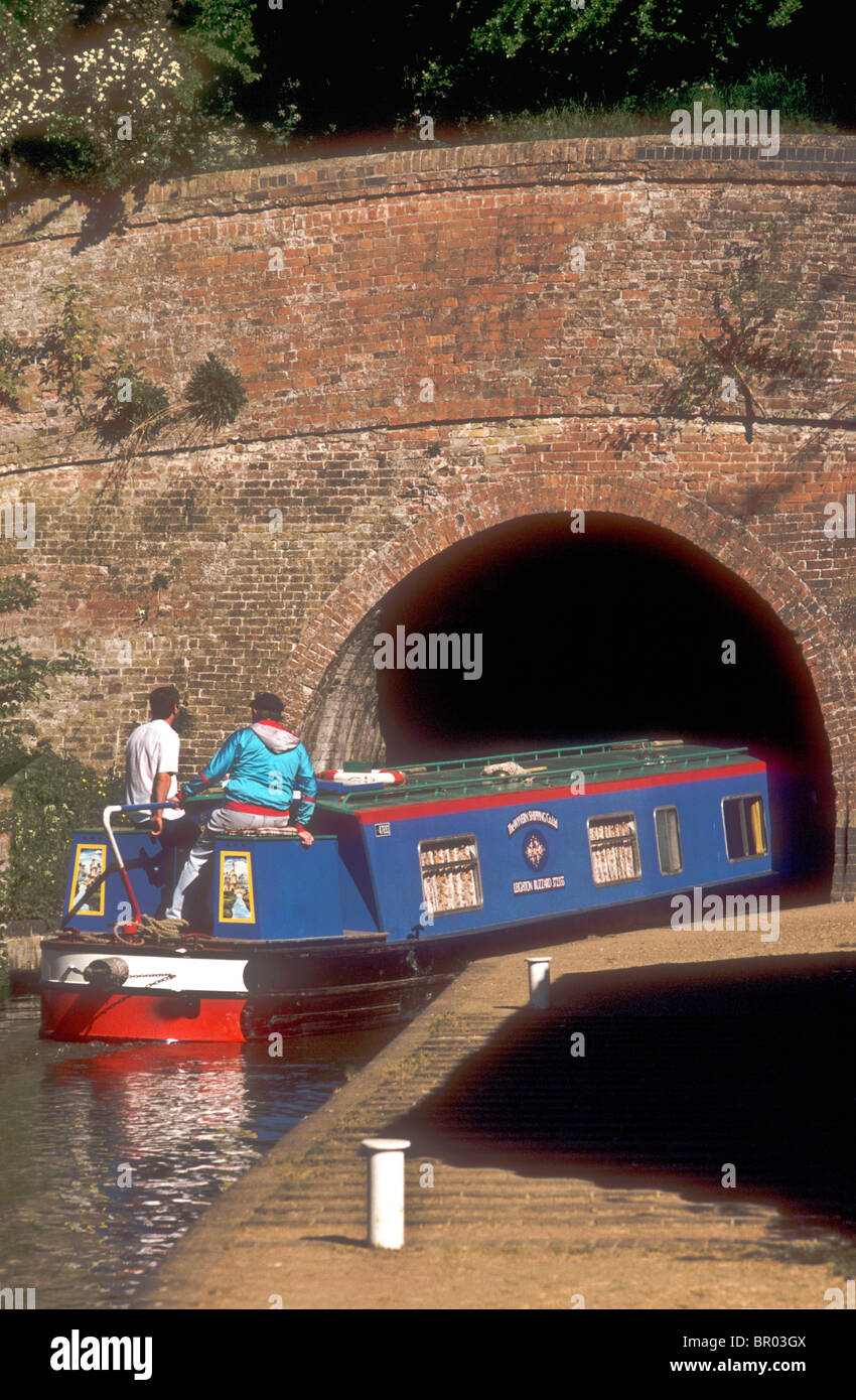 A narrowboat enters the Blisworth canal tunnel at Stoke Bruerne Northamptonshire England UK - Stock Image