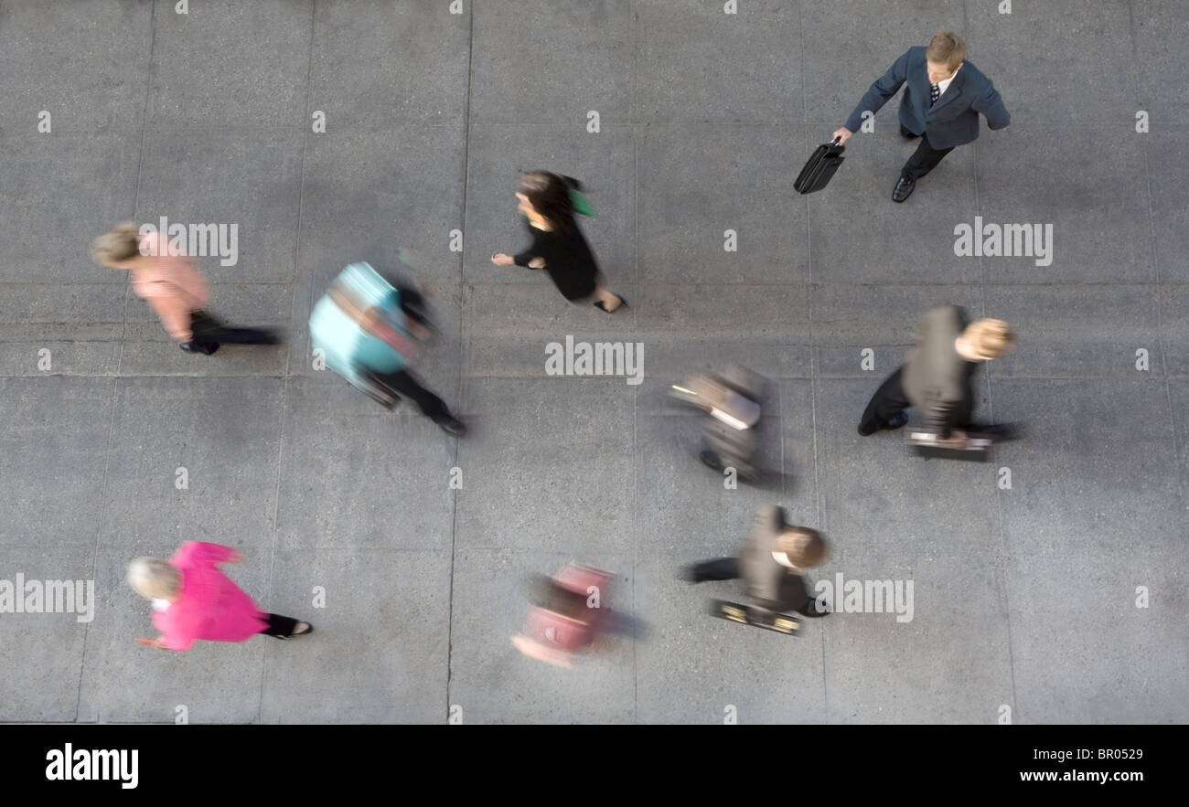 crowd of people walking shot from above with blur for motion - Stock Image