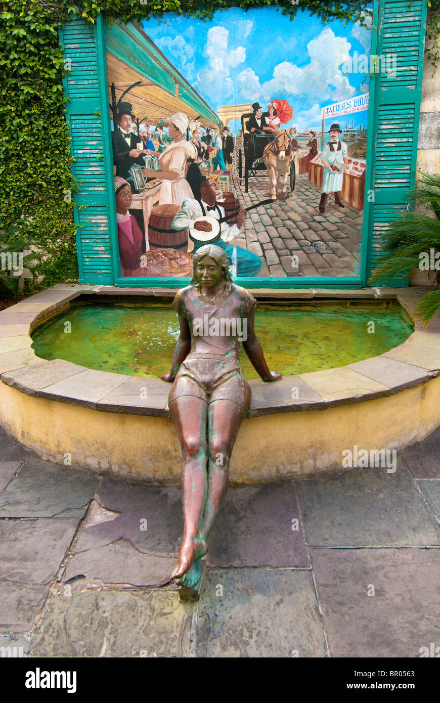 French Market fountain, statue and painting in the French Quarter of New Orleans, Louisiana, USA - Stock Image