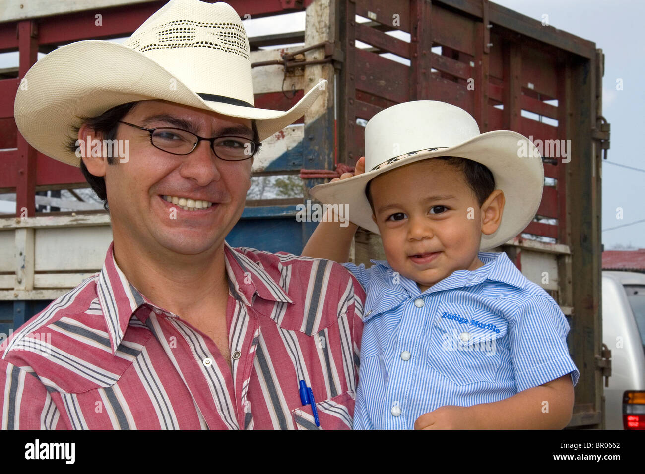 Costa Rican rancher and his son at Liberia, Costa Rica. MR - Stock Image