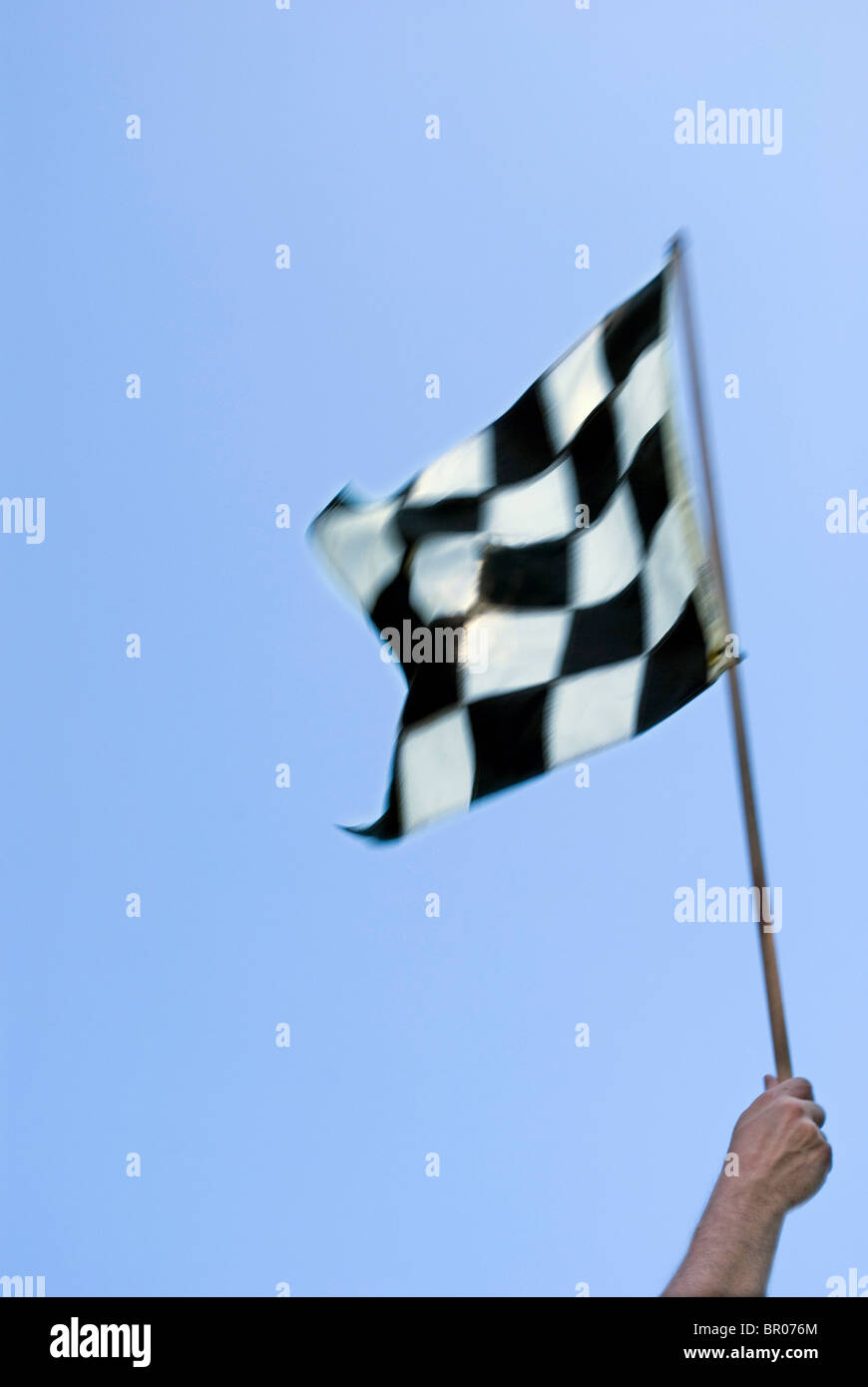 black and white checkered racing flag - Stock Image