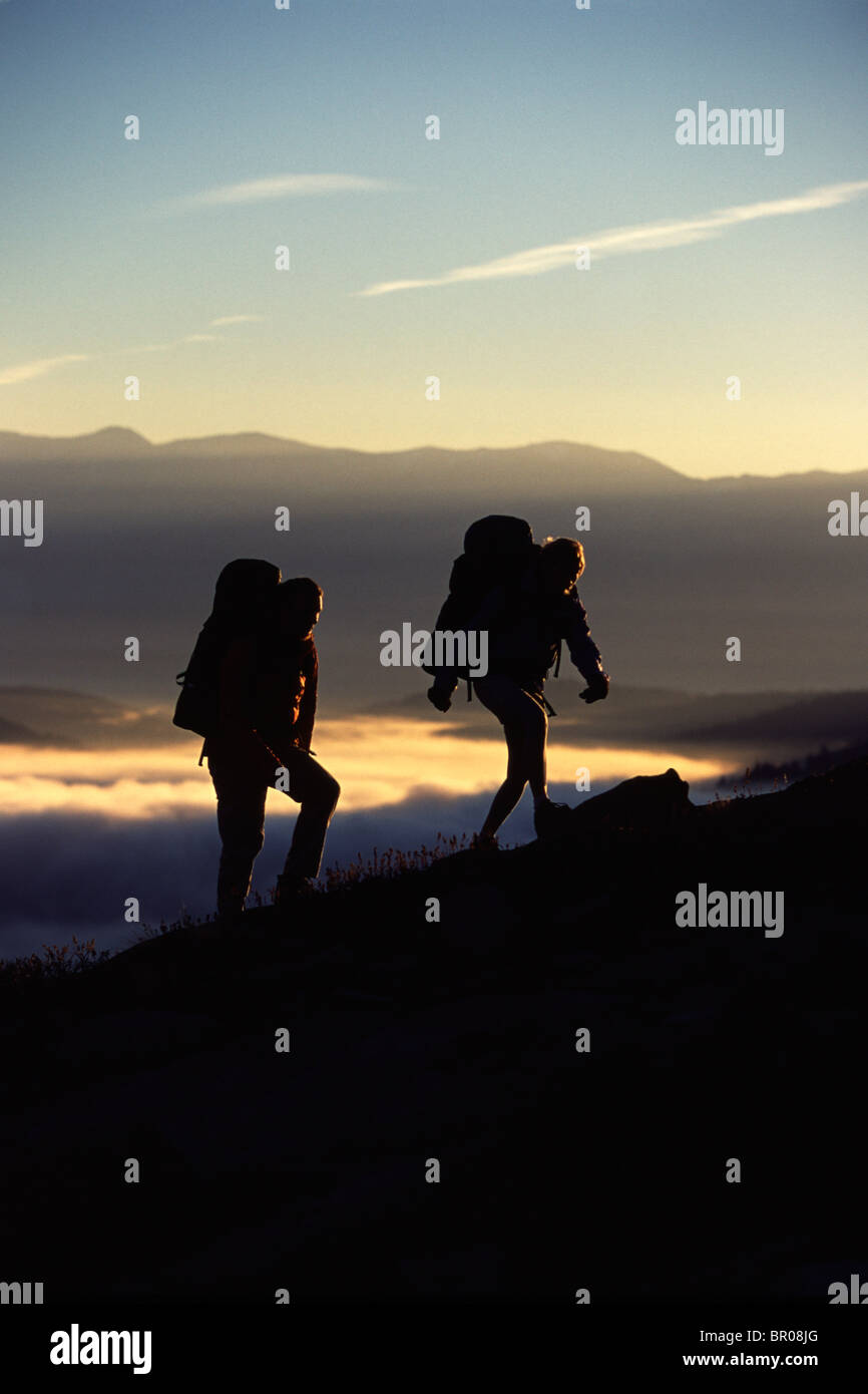 A Couple Hiking Above the Clouds - Stock Image