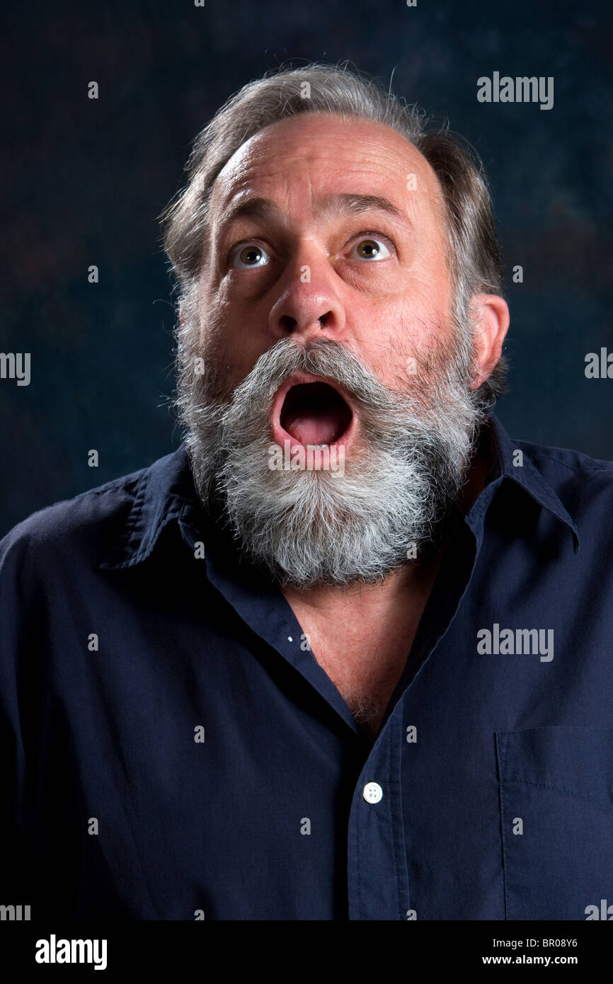 Man's reaction to an amazing event. - Stock Image