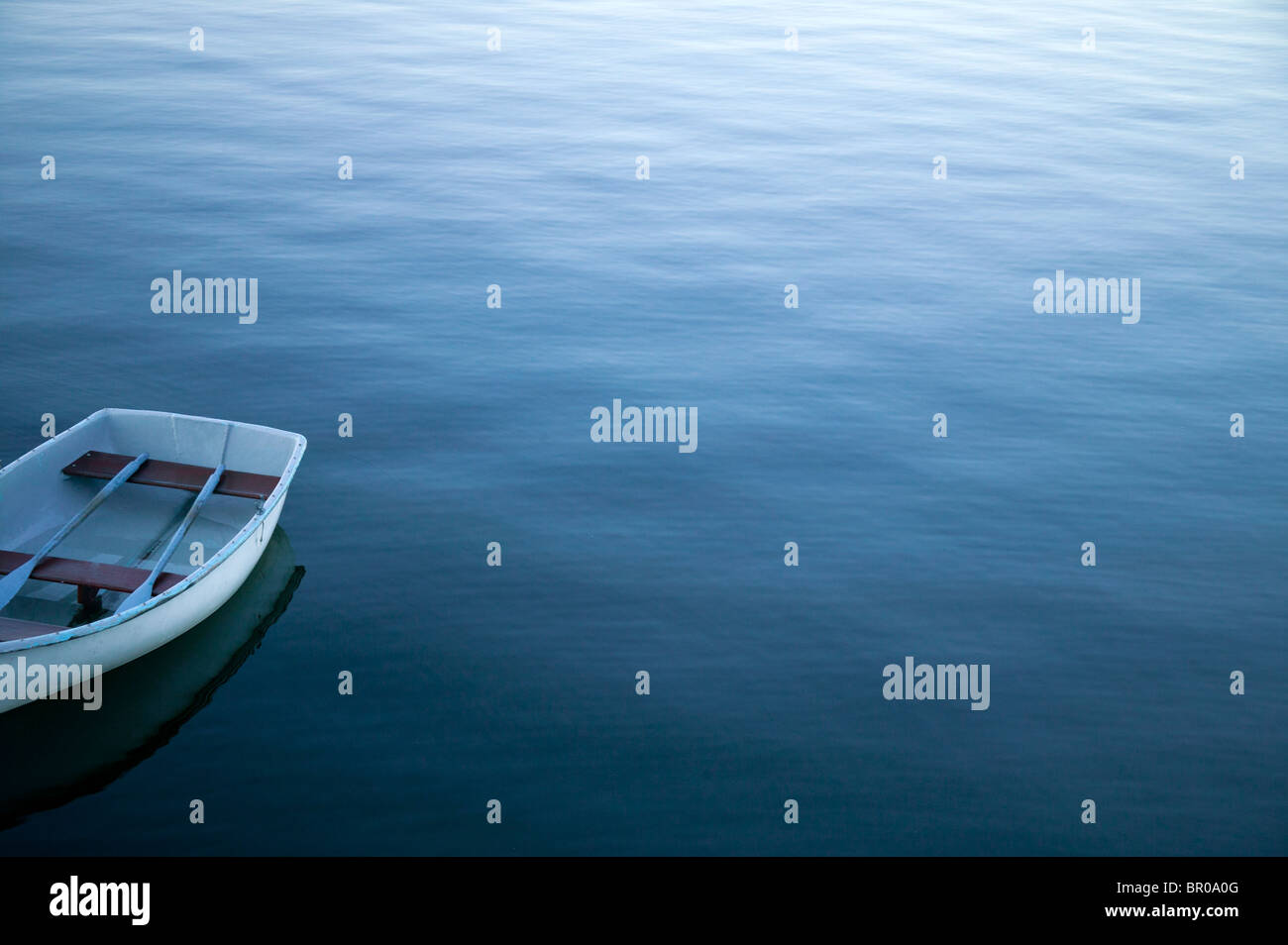 row boat in calm water - Stock Image