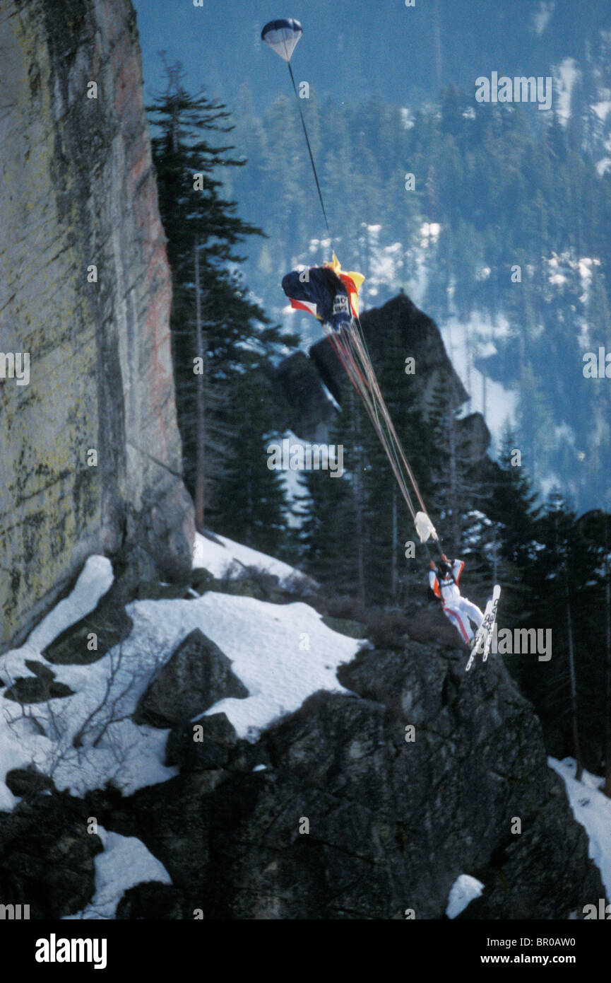 Ski-BASE jumper doing a front flip off a cliff near Lake Tahoe. - Stock Image