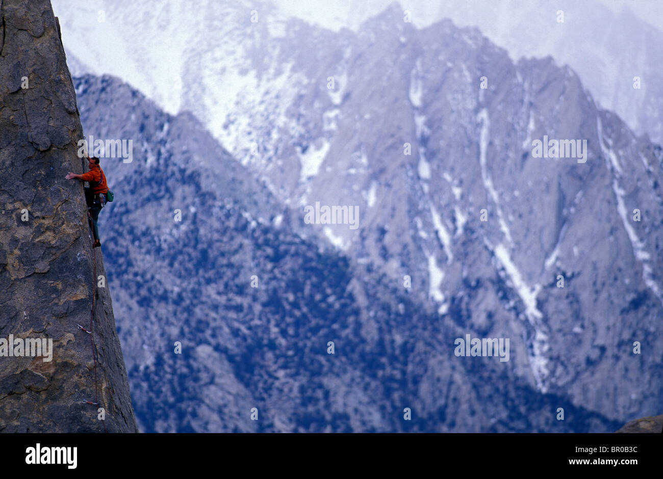 A male rock climber in an alpine setting. - Stock Image