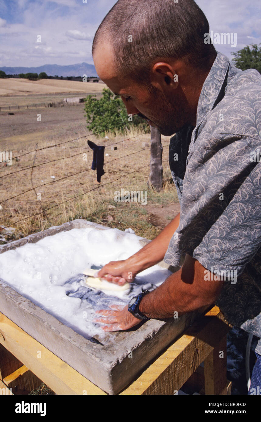 Man scrubbing laundry. Cananea, Mexico - Stock Image