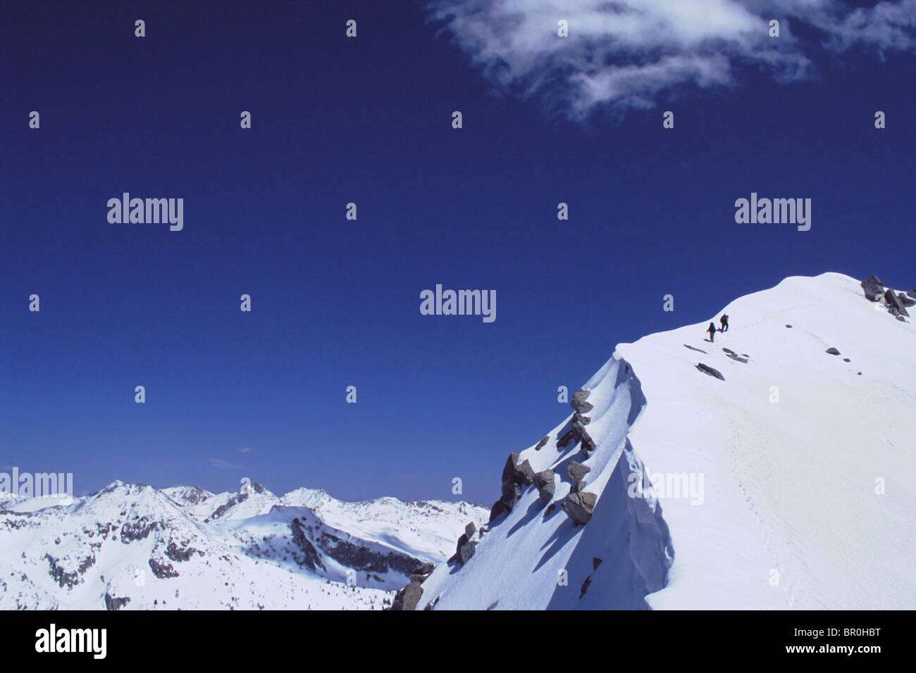 Mountaineering in winter on the summit of a peak in the Wasatch Mountains in winter. - Stock Image