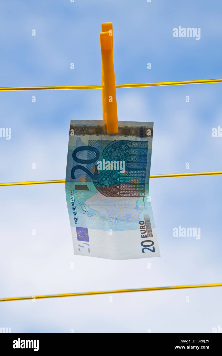 20 Euro note hanging on clothes line - Stock Image