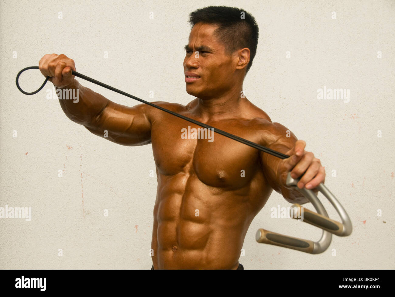 bodybuilder shows his muscles at a competition in Bangkok Thailand - Stock Image