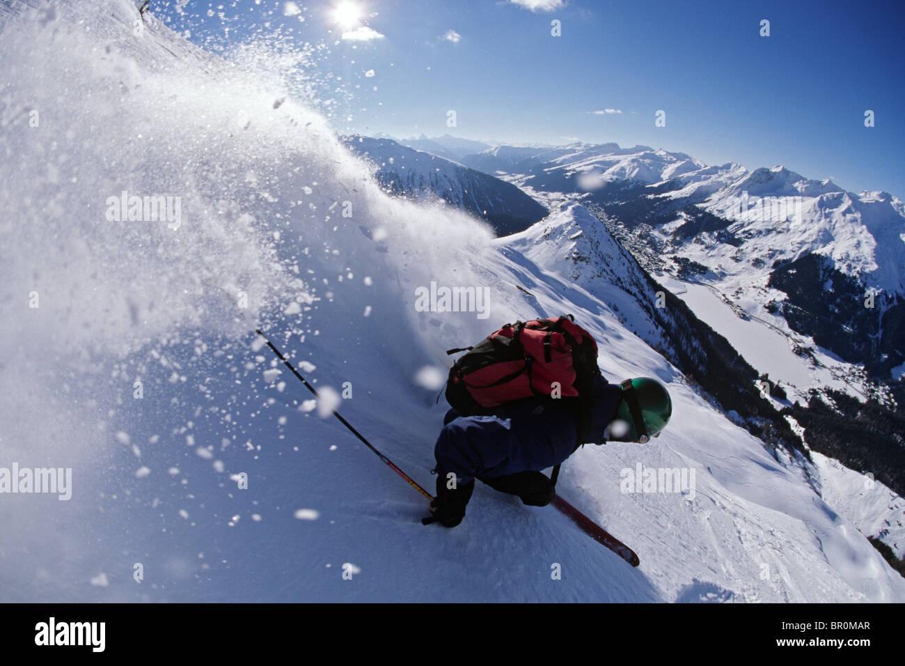 man skiing, Switzerland - Stock Image