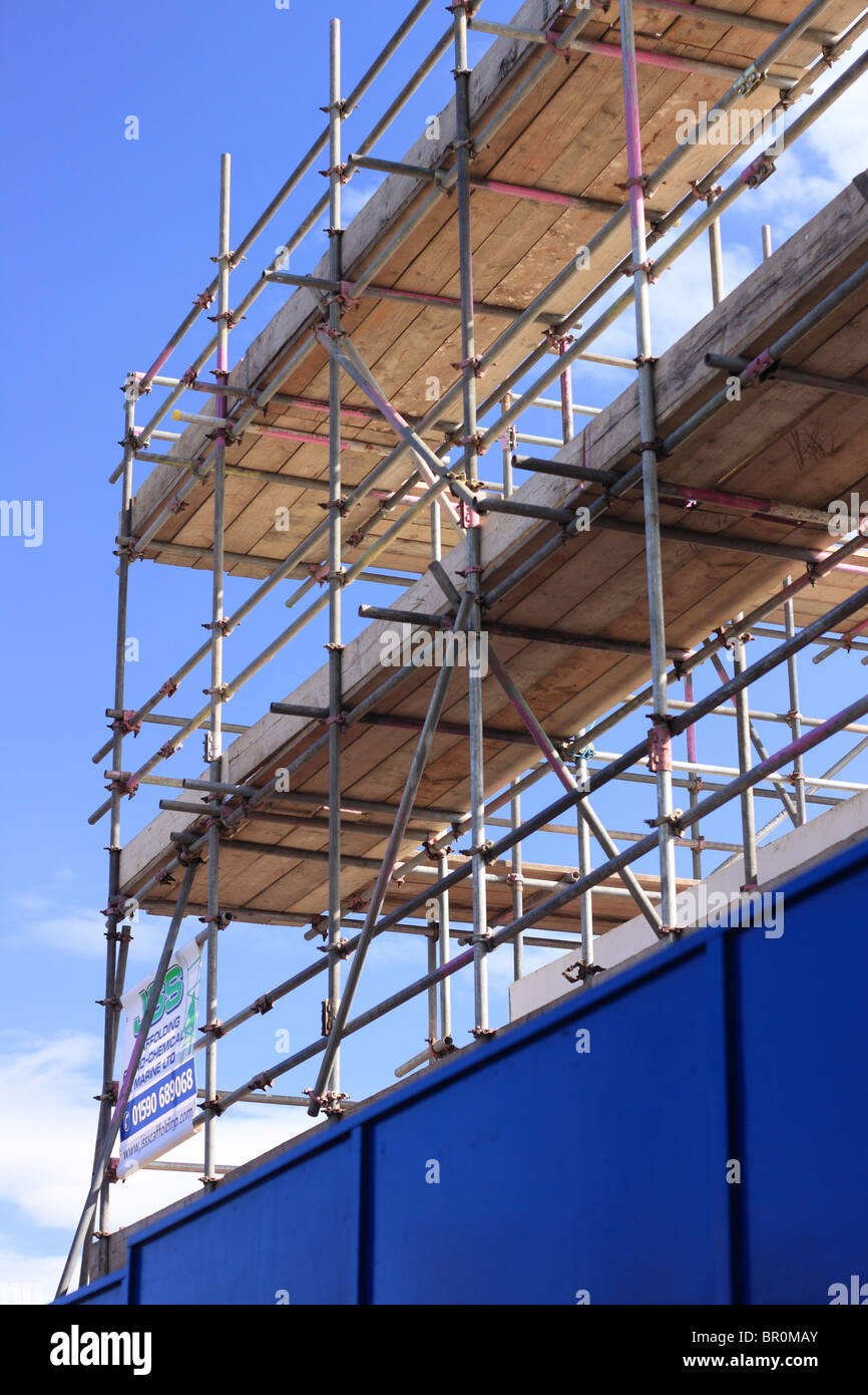 A Portrait section of the scaffolding on the building of a new Branch of Lidl supermarket. - Stock Image