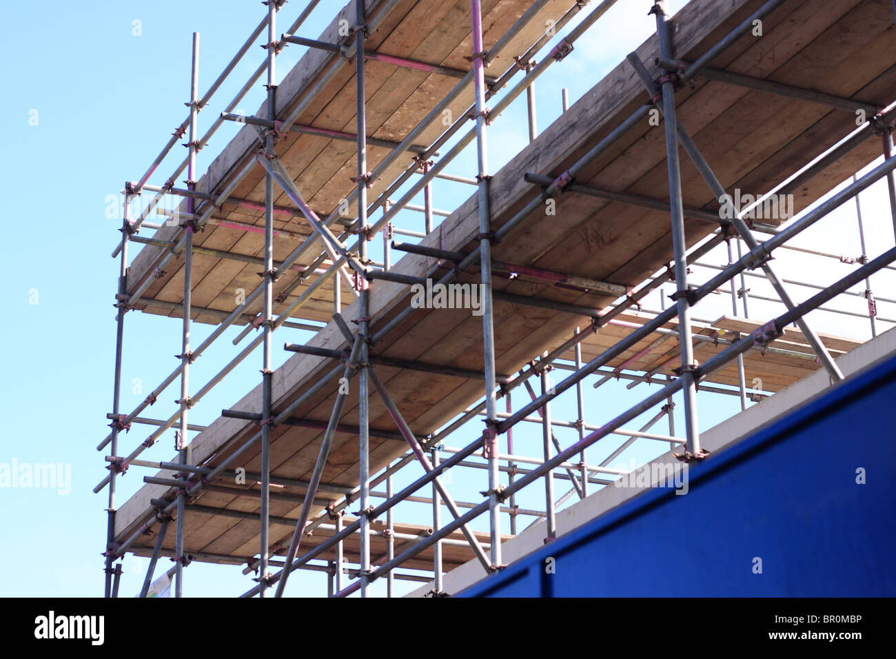 A section of the scaffolding on the building of a new Branch of Lidl supermarket. - Stock Image