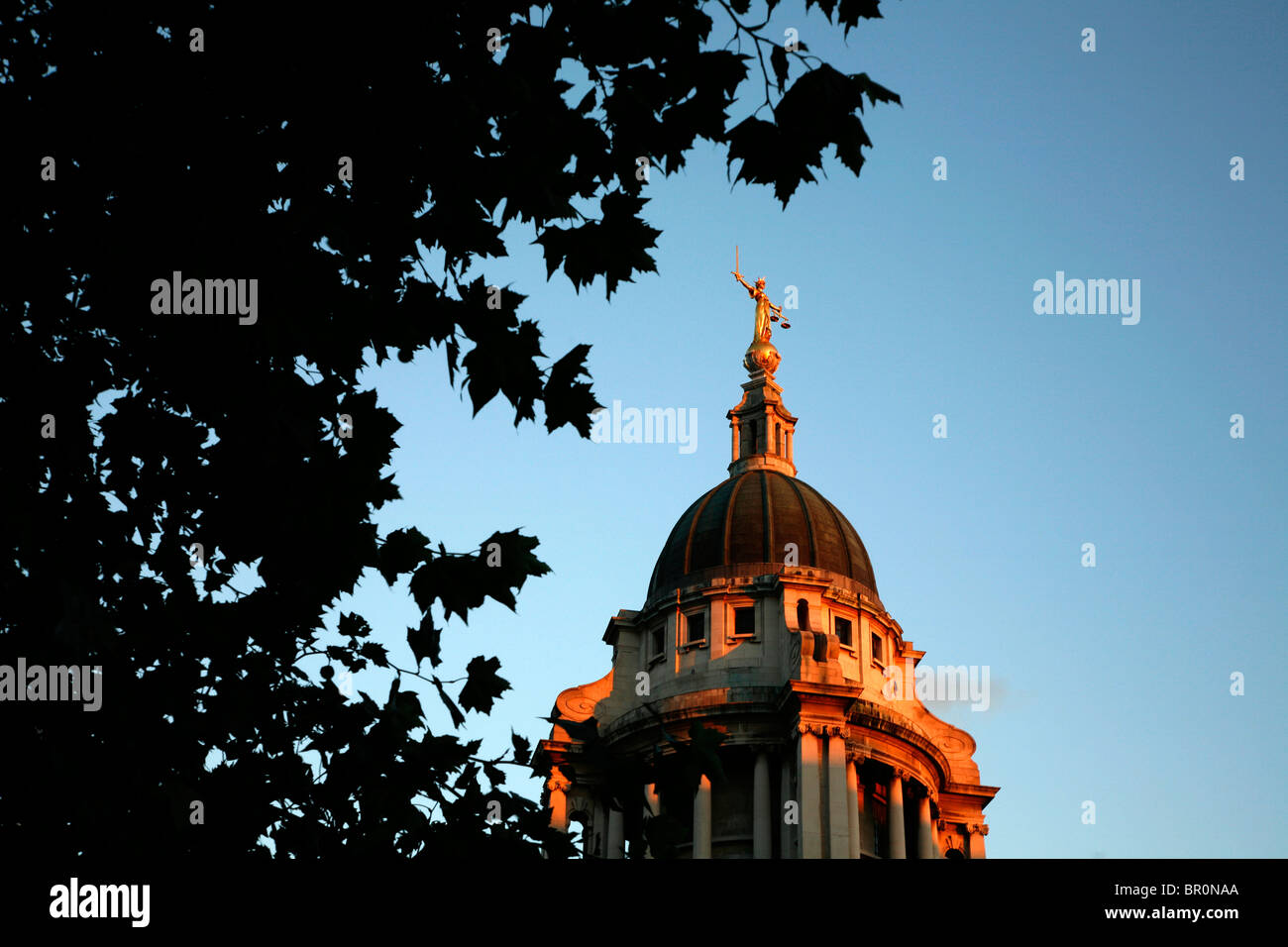 Justice statue stands atop the Old Bailey (Central Criminal Court), City of London, UK - Stock Image