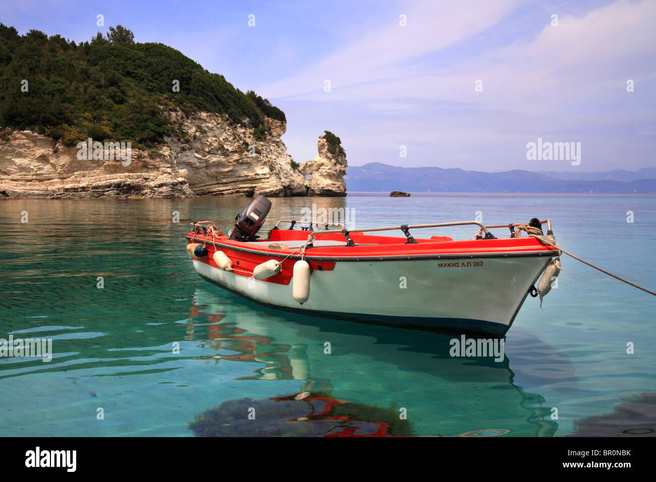 Fishing boat moored in a sheltered bay on Antipaxos, Greece. A small Island off the coast of Paxos - Stock Image