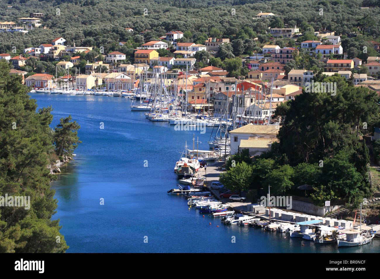 Gaios port, fishing boats and sailing boats with the greek town behind. Paxos is a small Ionian Island. Stock Photo
