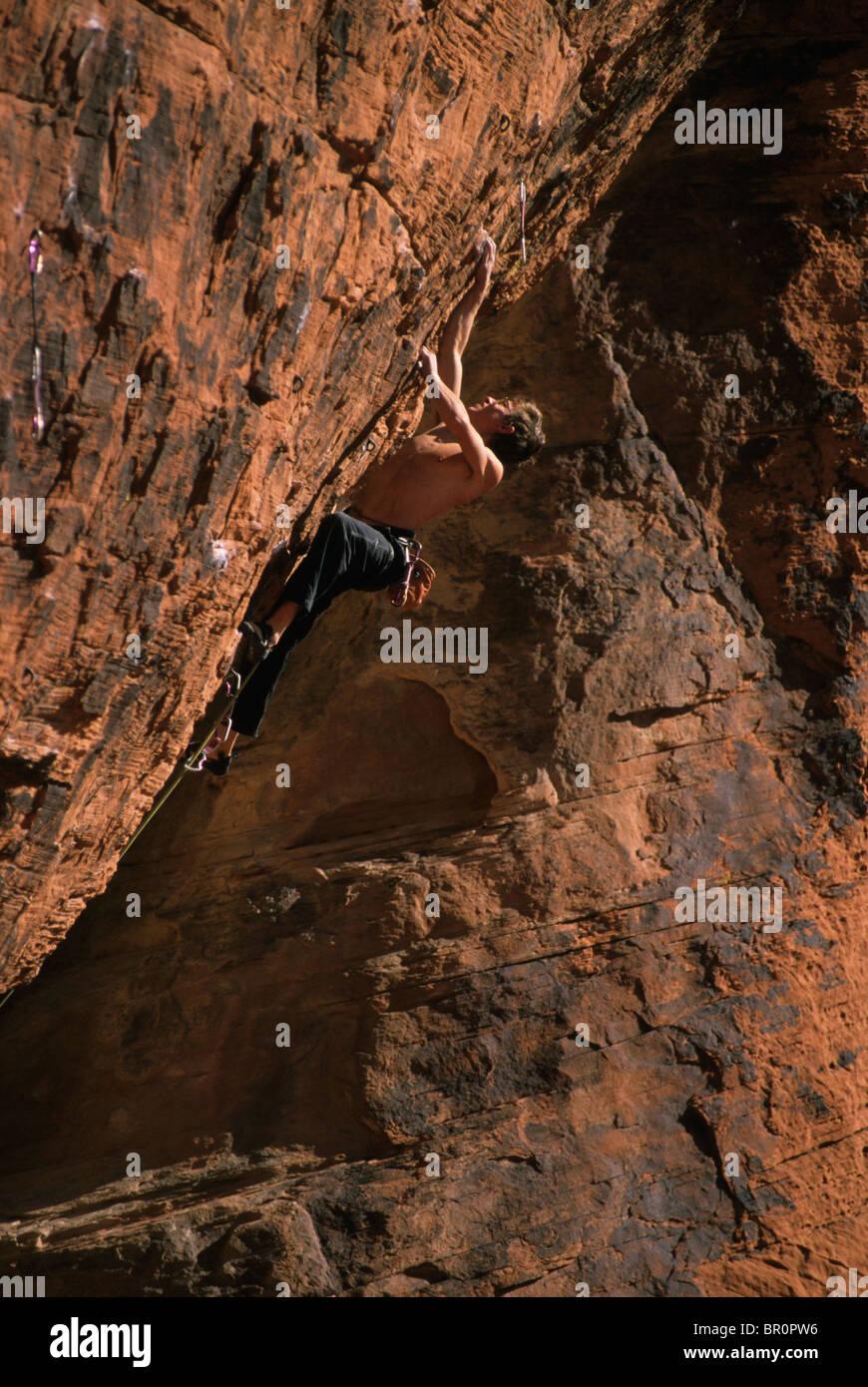 Rock climber on Nothing Shocking. Red Rocks, Nevada, USA. - Stock Image