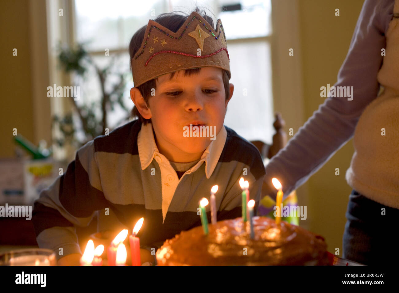 A Young Boy Blows Out Candles And Celebrates His 6th Birthday At Home In Yarmouth Maine