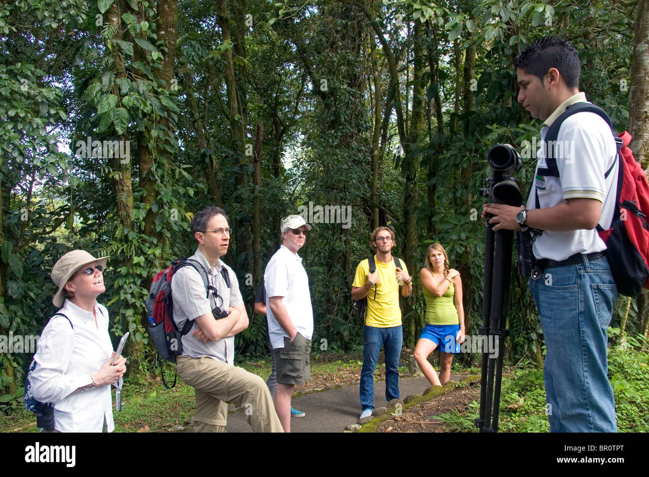 Naturalist guide talking to a group of birdwatchers in the Arenal Volcano National Park near La Fortuna, San Carlos, - Stock Image
