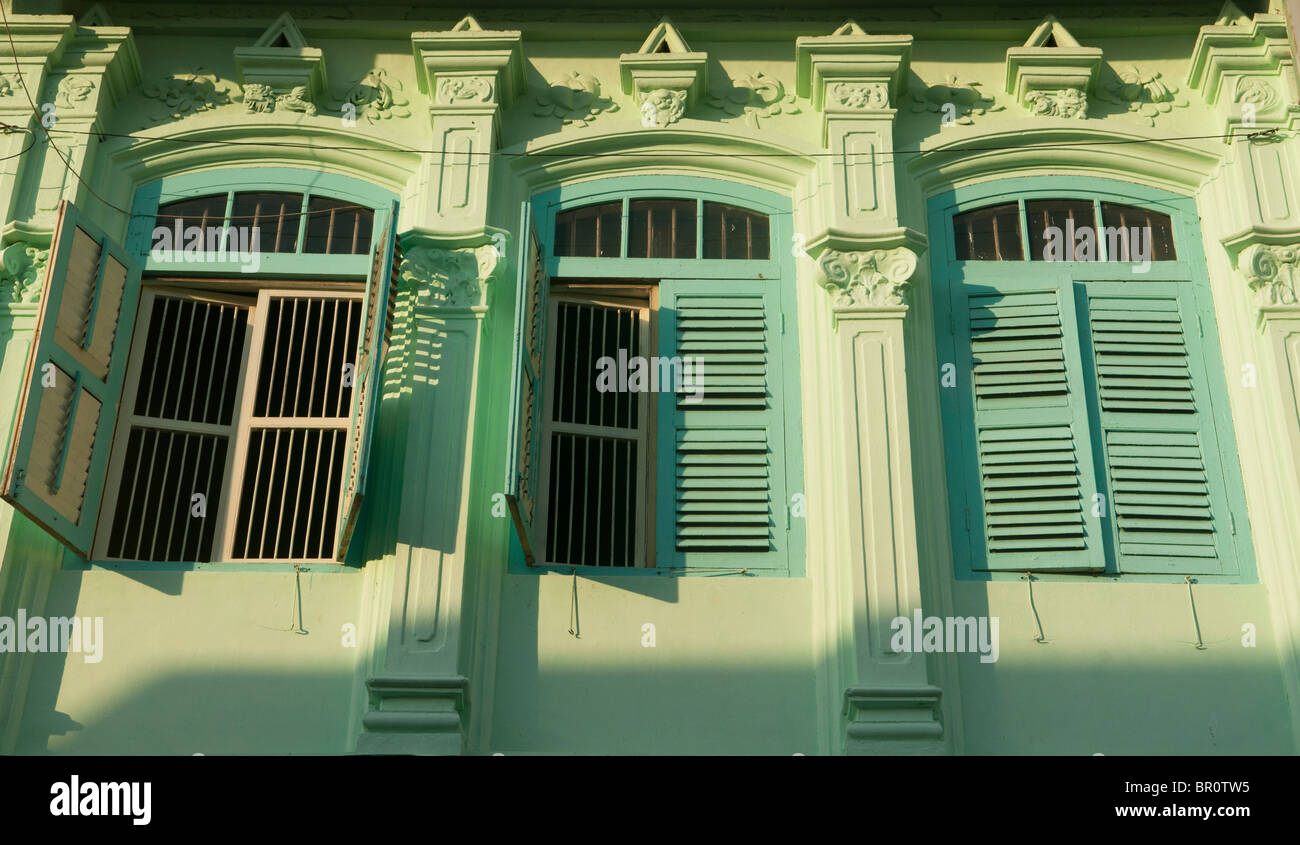 windows on traditional Chinese shophouse in Georgetown, Penang, Malaysia - Stock Image