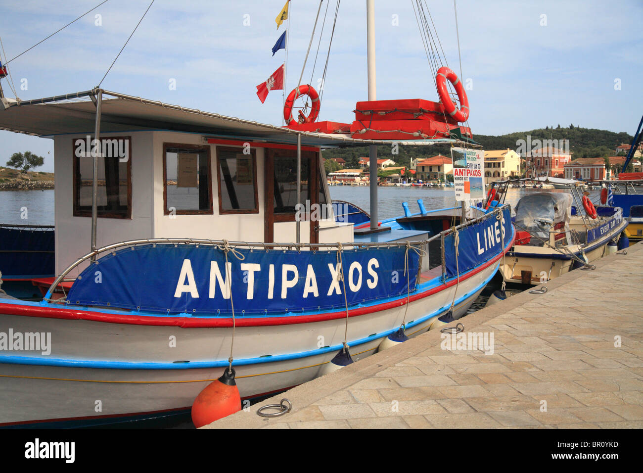 Antipaxos tourist day trip boat moored in Gaios harbour on Paxos and small Ionian island, Greece. - Stock Image