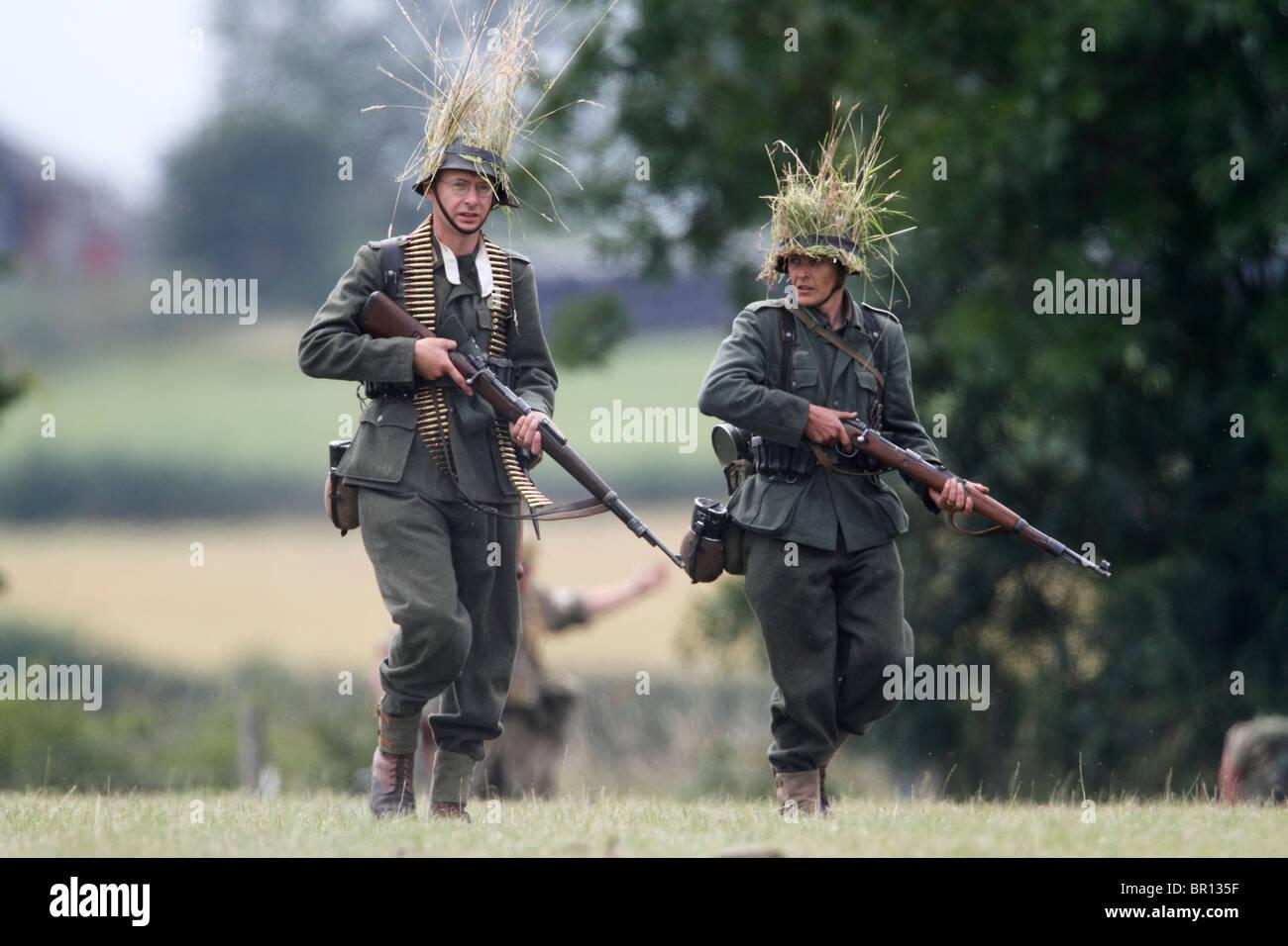 WWII re-enactment. German infantry (Schutzen). Wearing M40 Field tunic, Feldbluse, and field-grey trousers, Feldhosen. - Stock Image