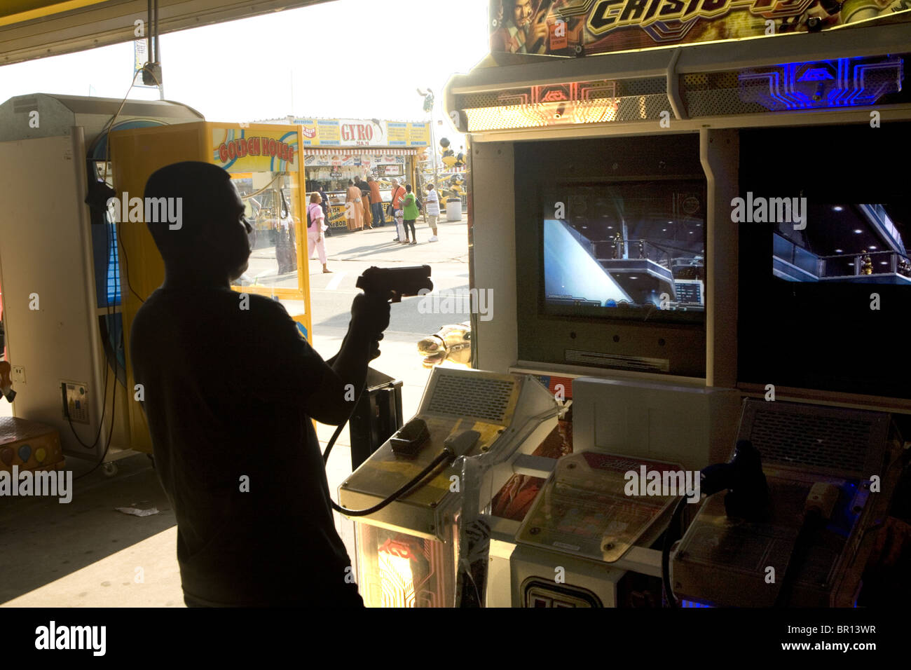 Young man in a video game arcade at Coney Island, Brooklyn, New York - Stock Image