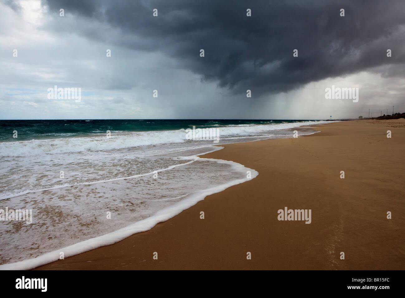 Rain falling at the beach - Stock Image