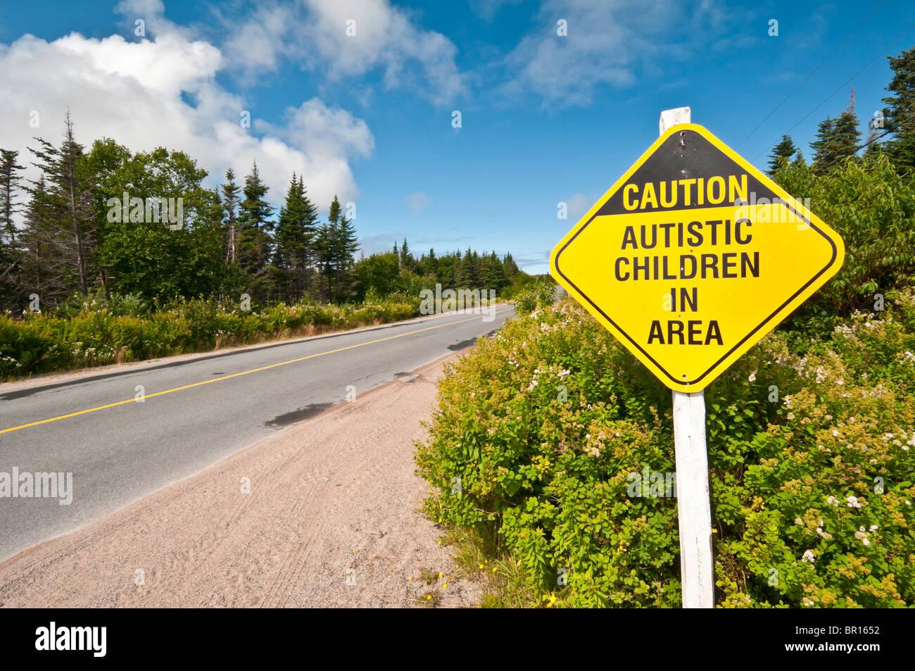 Caution Autistic Children in Area, road sign, Elliston, Bonavista Peninsula, Newfoundland, Canada - Stock Image