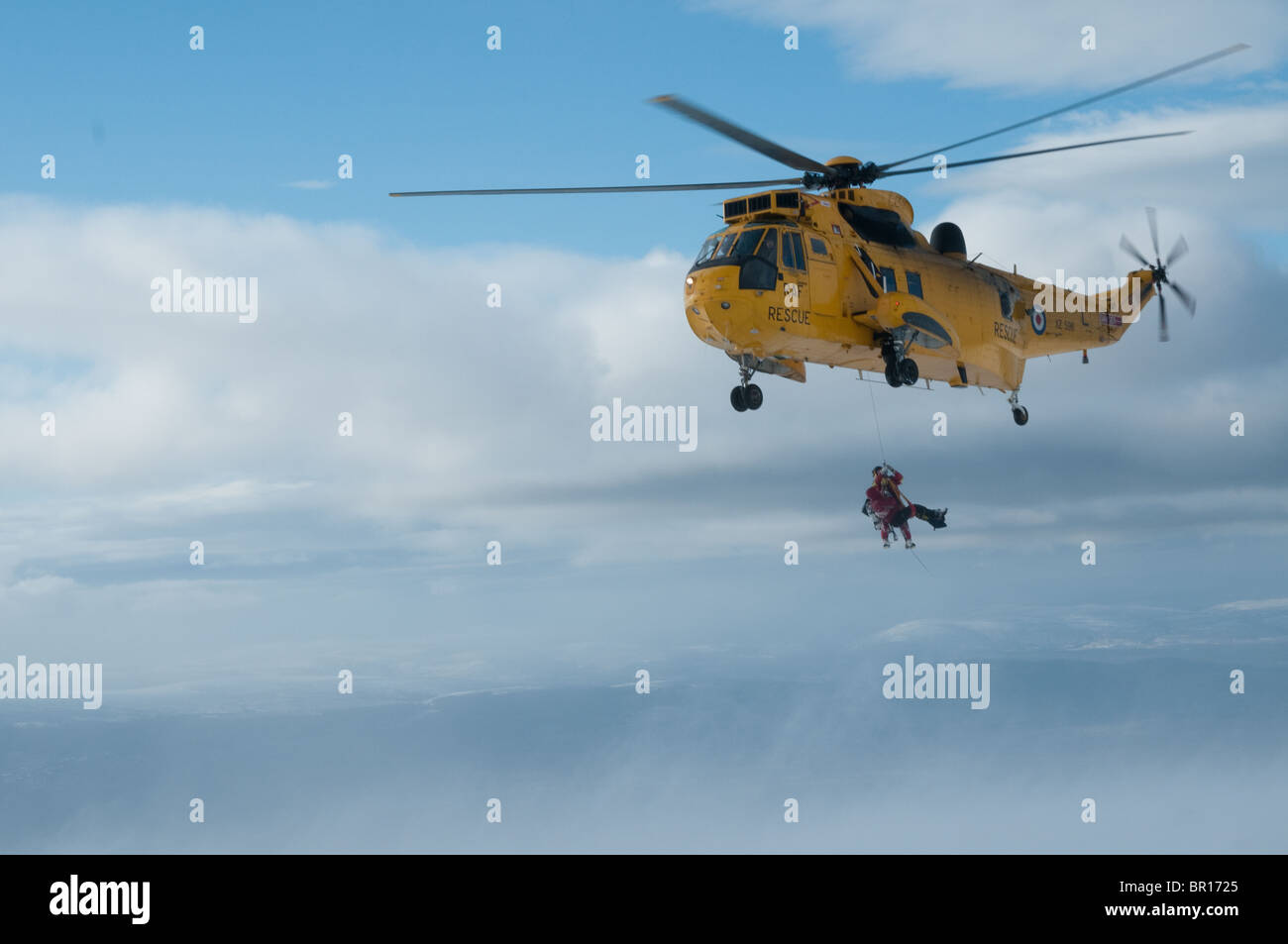 Sea King helicopter rescue of climbers by RAF mountain rescue in Coire an Lochain, Northern Corries, Cairngorms - Stock Image
