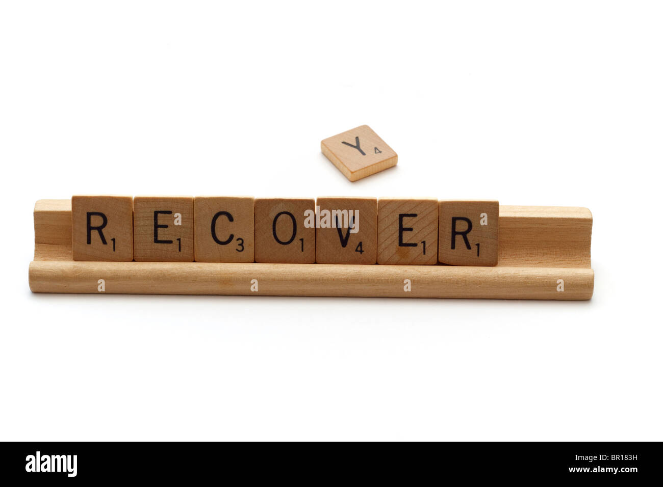 Incomplete recovery concept illustrated using Scrabble tiles - Stock Image