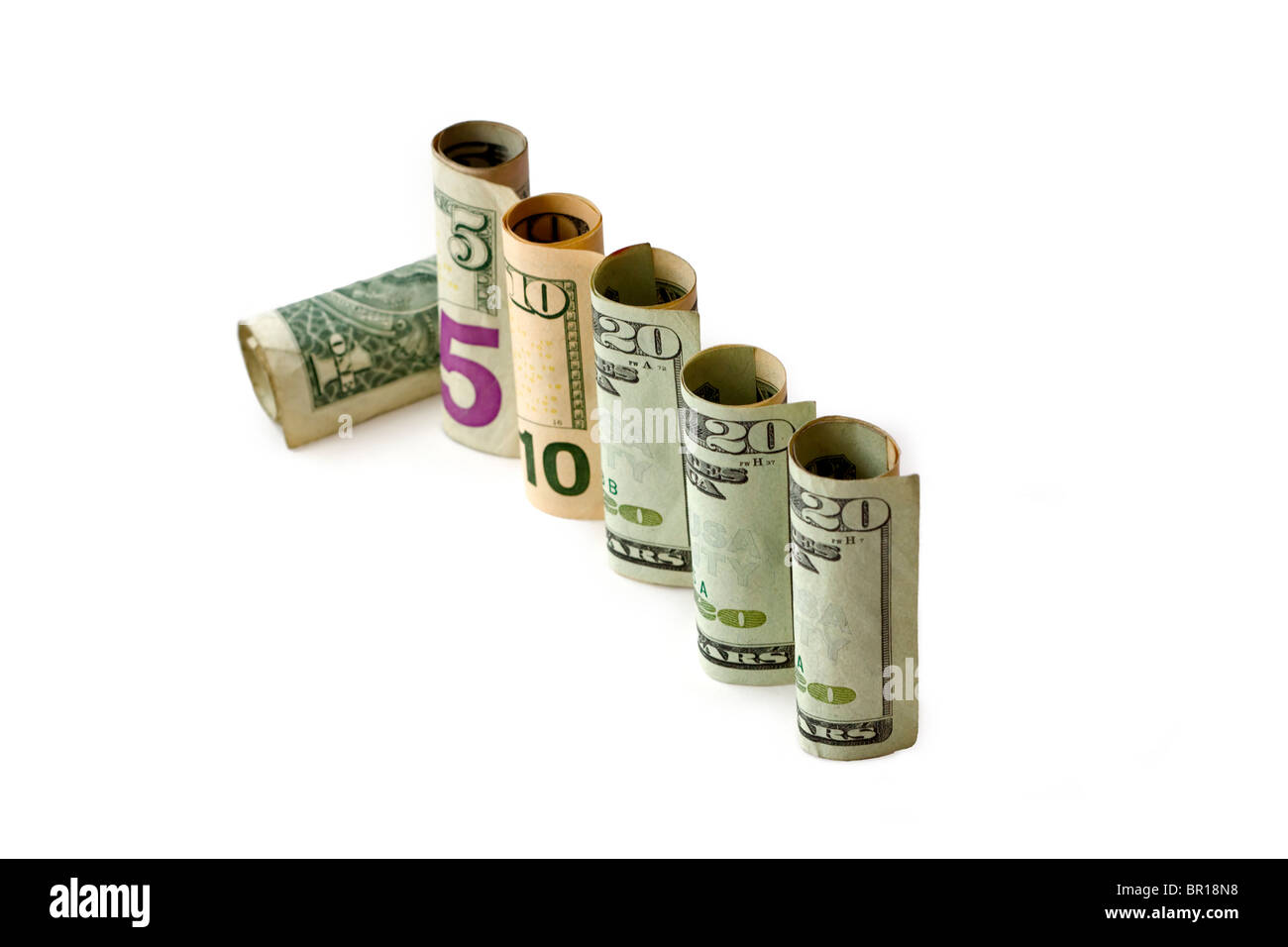 Recession concept illustrated with a row of banknotes and the last one fallen over - Stock Image