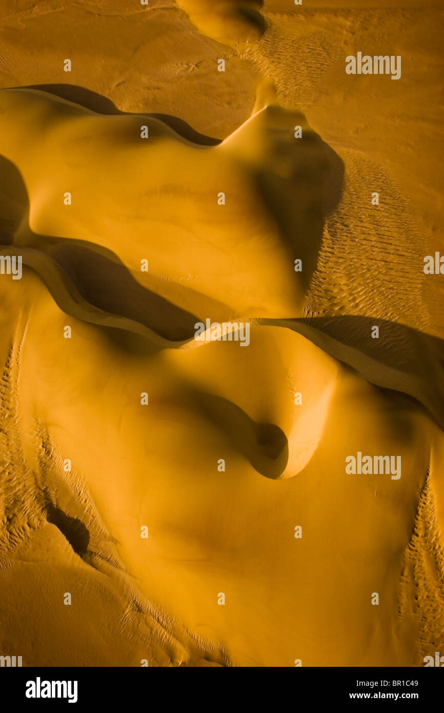 An aerial view of the crescent-shaped dunes of the Namib Desert on the Skeleton Coast in Namibia. - Stock Image