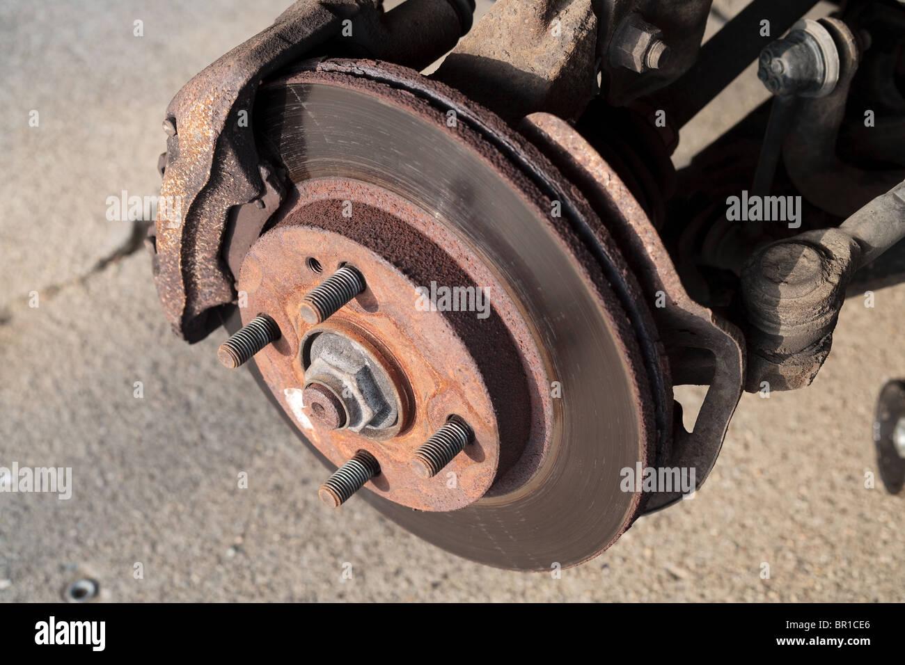 A car's brake caliper and rotor - Stock Image