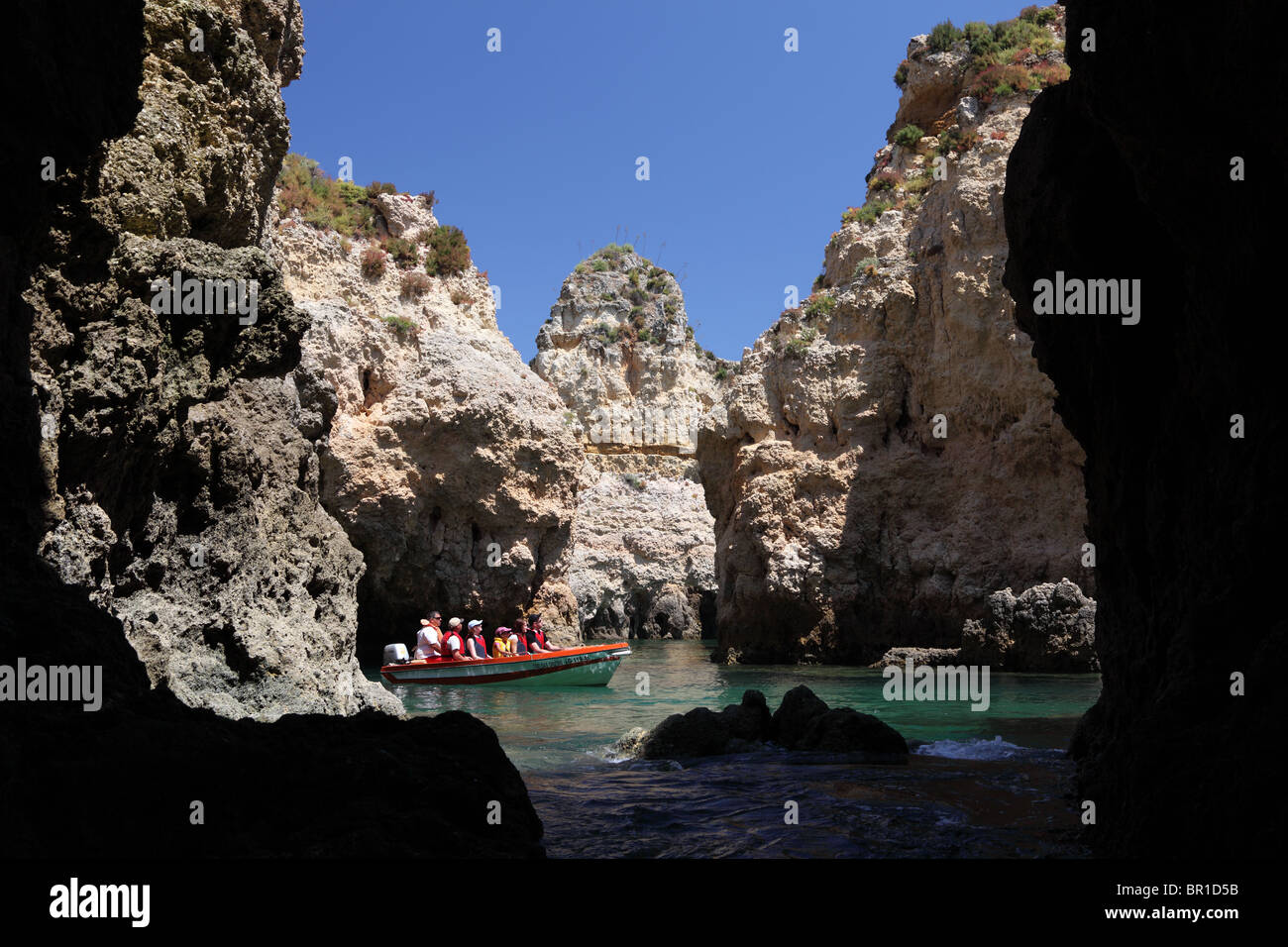 Tourists discovering the cliffs near Lagos, Algarve Portugal - Stock Image