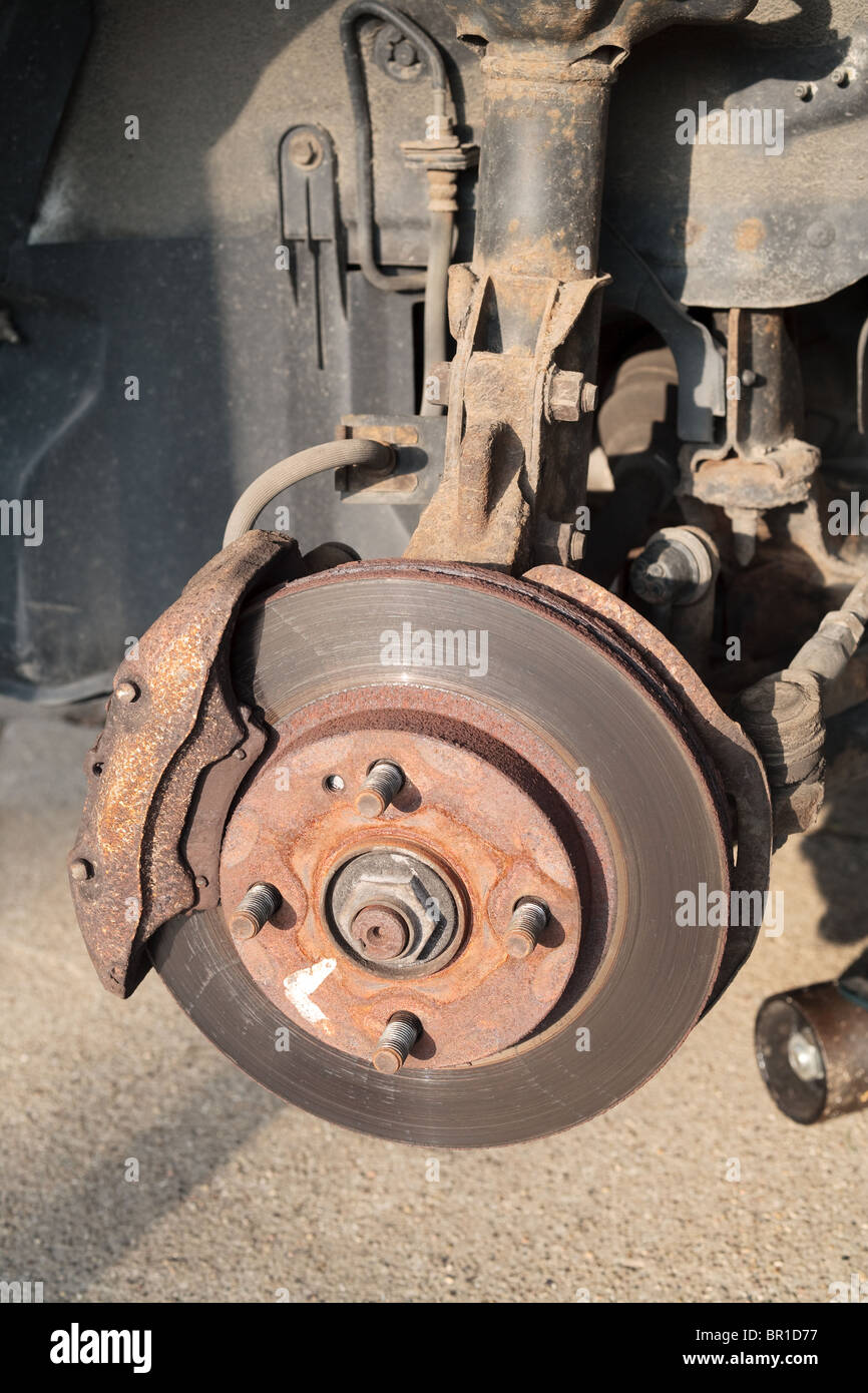 A car's brake caliper and rotor. - Stock Image