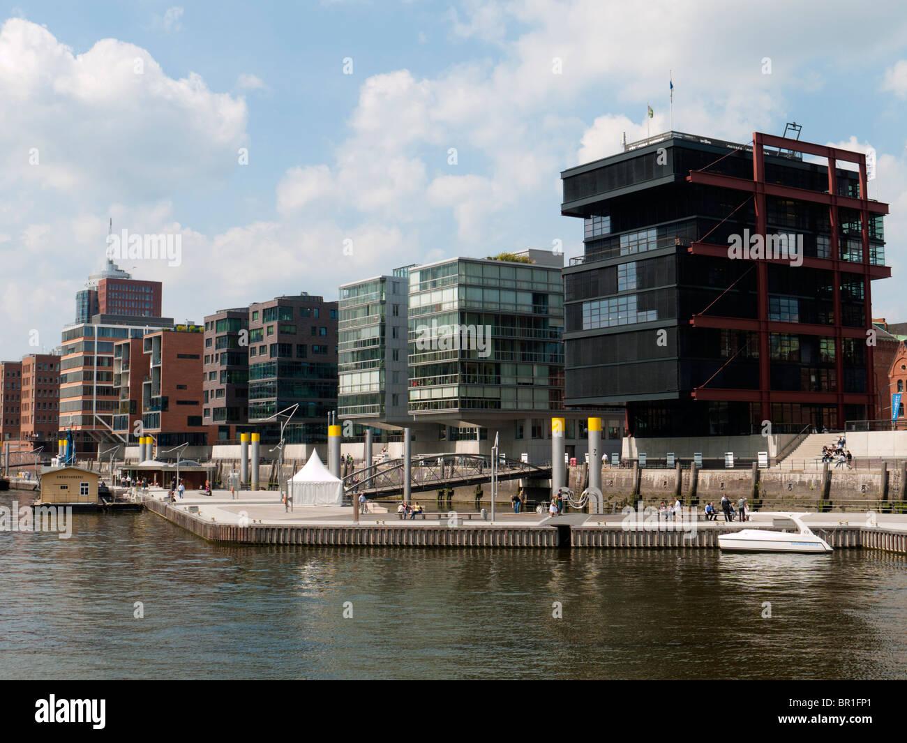 Modern apartment buildings constructed Sandtorhafen in new Hafencity property development in Hamburg Germany - Stock Image