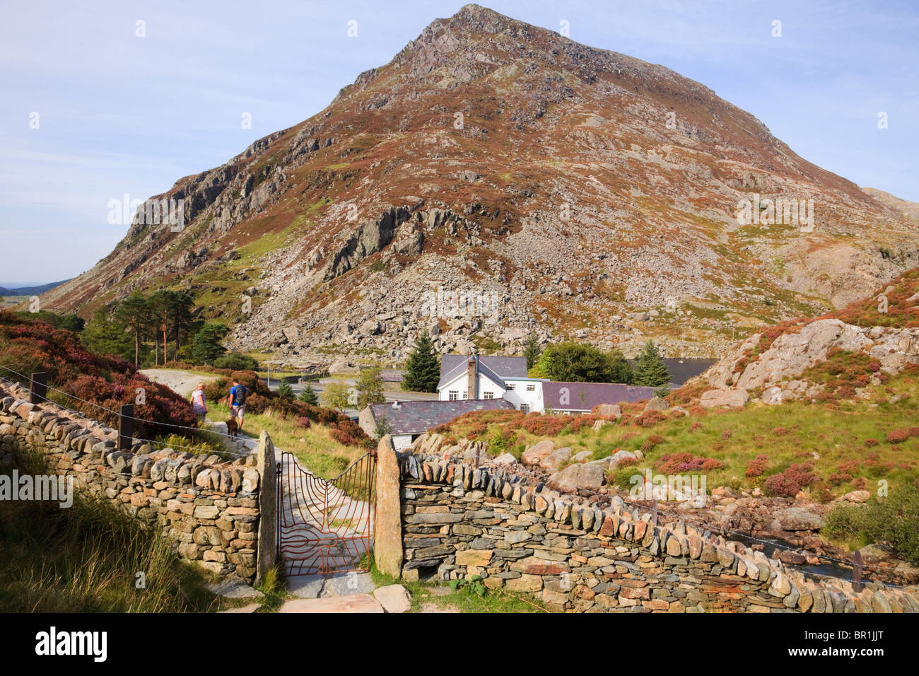 Path from Cwm Idwal with Ogwen Cottage Outdoor Pursuits Centre and Pen Yr Ole Wen. Ogwen, Snowdonia, North Wales, - Stock Image