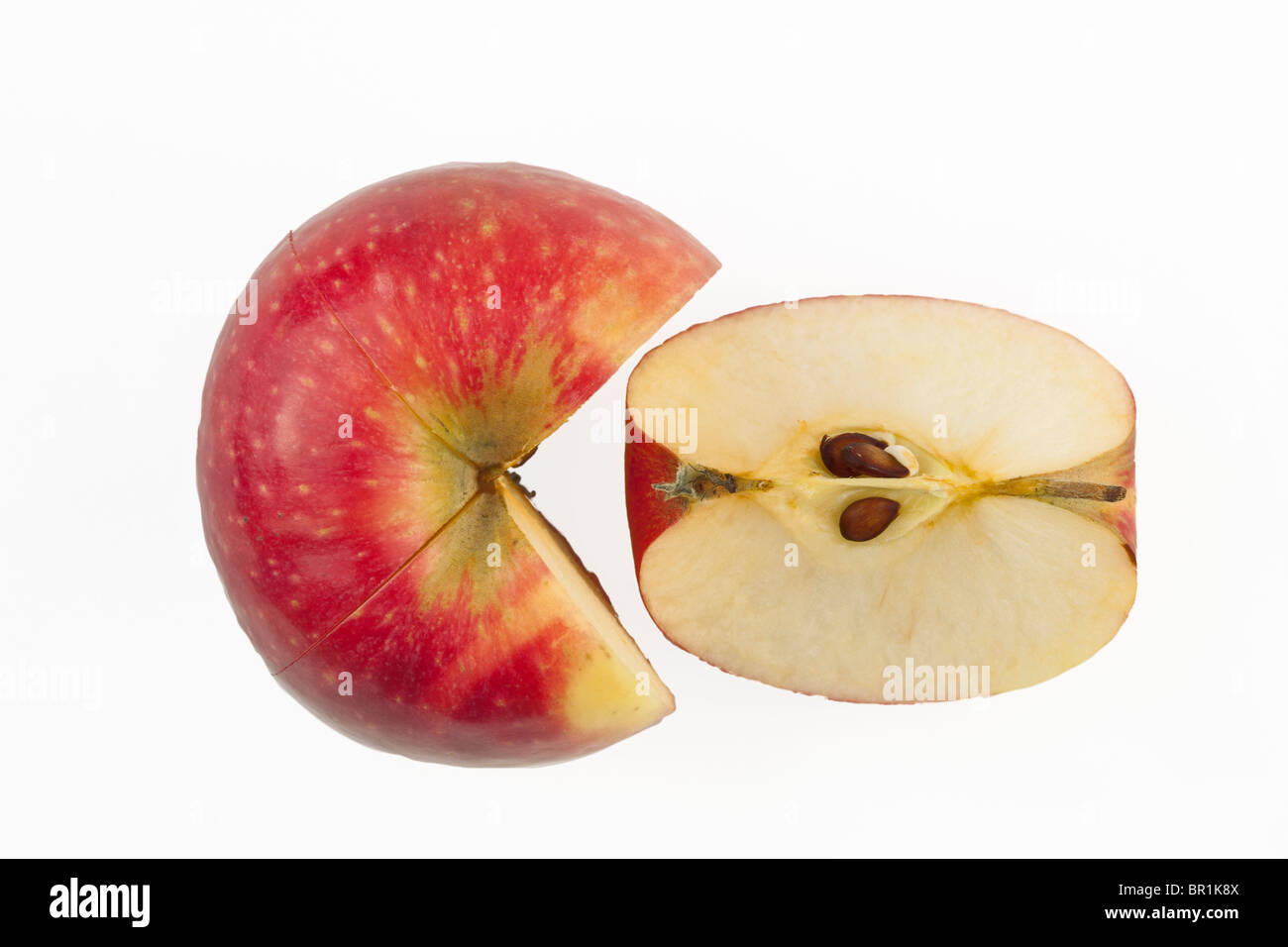 Apple half and round slice on a white background - Stock Image